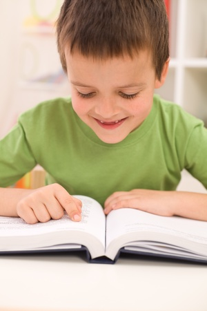 begins: Little boy remember reading before school begins - closeup