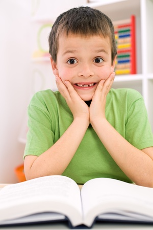 dyslexia: Little boy forgot reading - the stress of going back to school concept Stock Photo