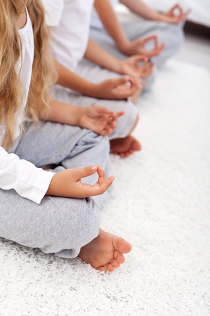 yoga meditation: Yoga lotus position detail of kids and adult - relaxation concept Stock Photo