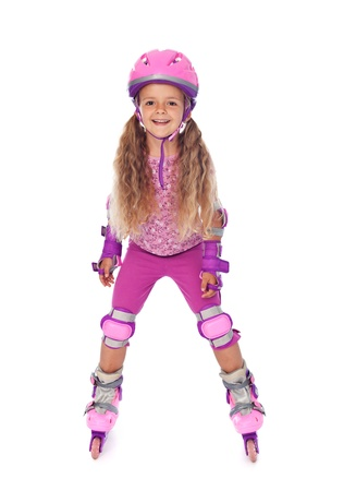 rollerskating: Roller skating little girl with protective gear, laughing - isolated