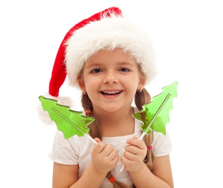 Happy little girl at christmas time with santa hat - isolated photo