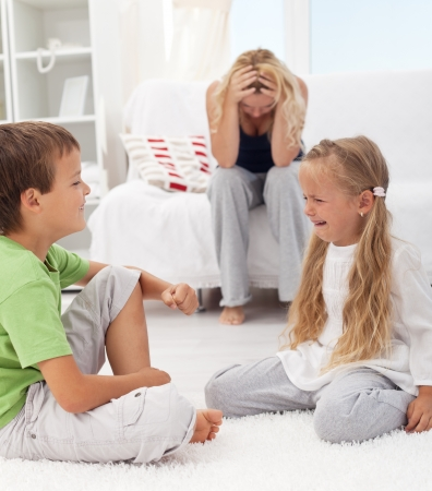 sibling rivalry: Kids having a quarrel and fight - tough parenthood concept