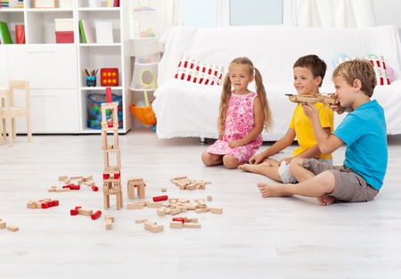 Kids playing with bow and arrow at home without supervision photo