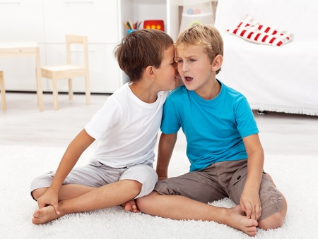 Did you hear this - gossip between two boys sharing secrets photo