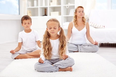 woman meditation: Family relaxing with yoga - balanced life concept