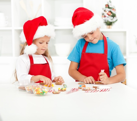 Kids decorating christmas cookies in the kitchen Stock Photo - 10986734