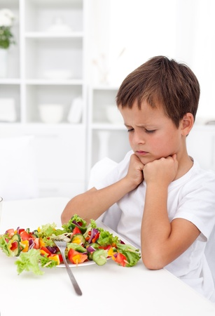 I will not eat that - boy with aversion towards his vegetables meal