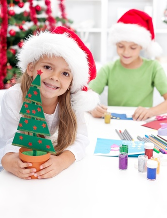 card making: Happy kids making christmas decorations and postcards Stock Photo