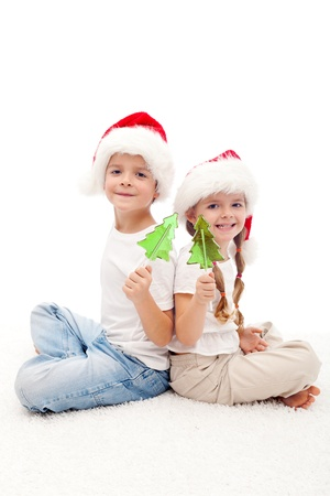 Christmas kids sitting on the floor with candy photo