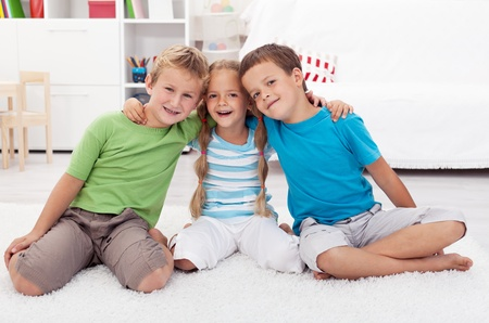 Childhood friendship between two boys and a girl Stock Photo