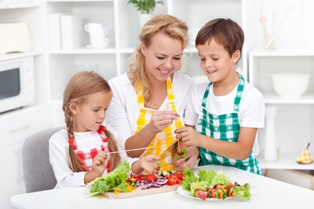 Preparing fresh food with the kids - healthy eating education photo