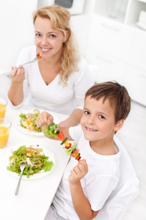 hungry kid: Happy people eating healthy food