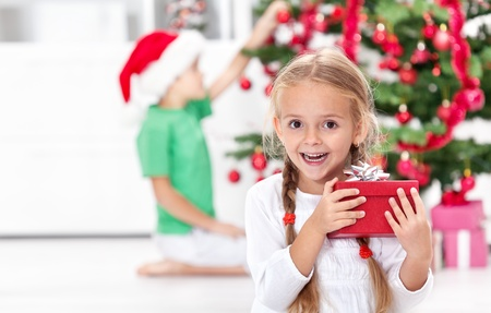 ecstatic: Childhood thrill of christmas - ecstatic little girl with present