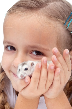 My best present ever - little girl happy for getting a hamster, closeup photo
