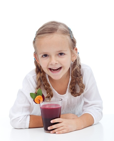 Healthy happy girl laughing with fresh beetroot and carrot juice photo