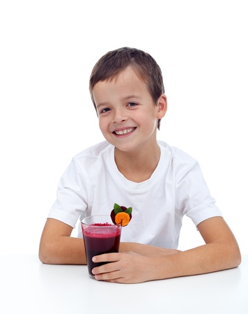 Laughing healthy boy with fresh beetroot and carrot juice photo
