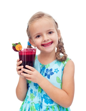 Healthy girl having a freshly squeezed betroot and carrot juice - isolated photo