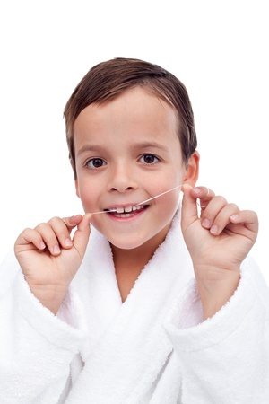 Little boy flossing his teeth - oral hygiene education concept photo