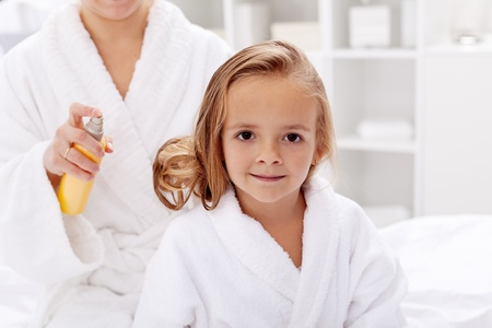 after bath: Hair care after bath - little girl having her beauty ritual