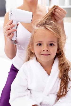after bath: Drying hair - little girls after bath activities Stock Photo