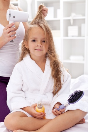 after the bath: Drying hair after bath - little girl personal hygiene activities