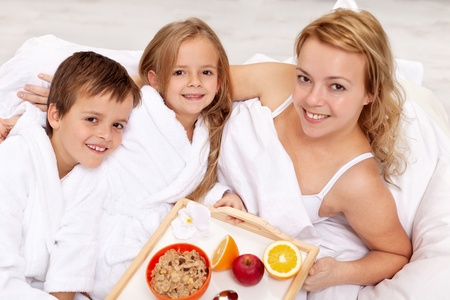 Breakfast in bed for our mom - kids pampering their mother photo