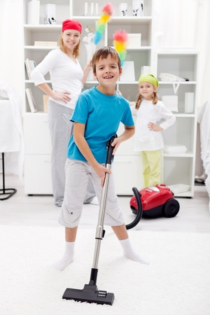 domestic chore: Clean up day - kids helping their mom doing chores Stock Photo