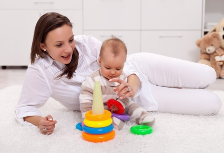 Beautiful baby girl playing with her mother at home Stock Photo - 12068093