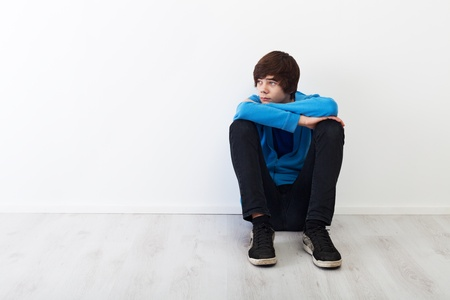 The times when every thought is big - serious teenager boy sitting photo