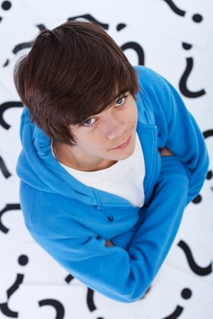 Teenager boy full of questions - curiosity and exploration concept Stock Photo - 12074800