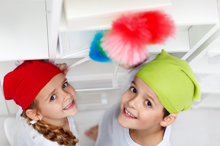 domestic chore: Kids dusting in their room - cleaning up day Stock Photo