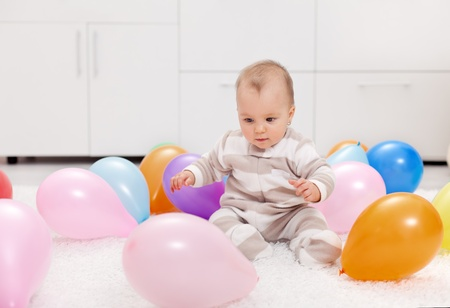 Oh I want those - baby girl with lots of colorful balloons photo
