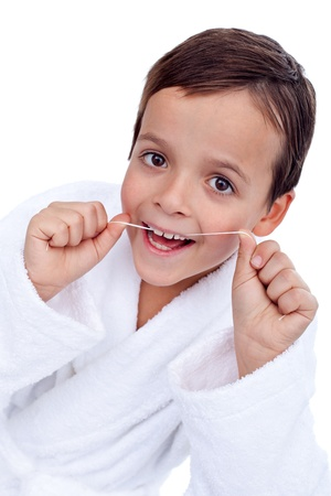 Little boy flossing teeth - closeup, isolated photo