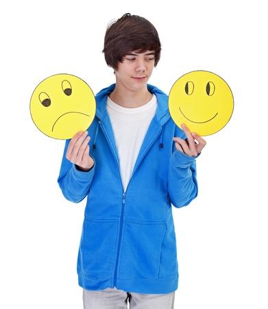 La elección de ser feliz - joven adolescente con máscaras alegres y tristes Foto de archivo - 12148724