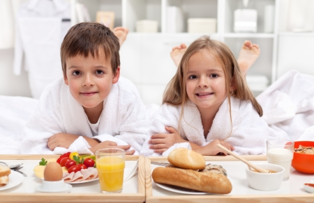 bathrobe: Kids having a healthy and various breakfast in bed
