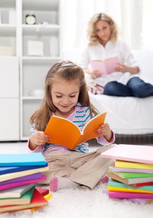 Shaping the habit of reading in kids - teaching by example Stock Photo - 12505681