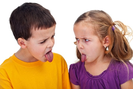 Kids with bad behavior - mocking each other with tongues sticking out, closeup Stock Photo - 12477534