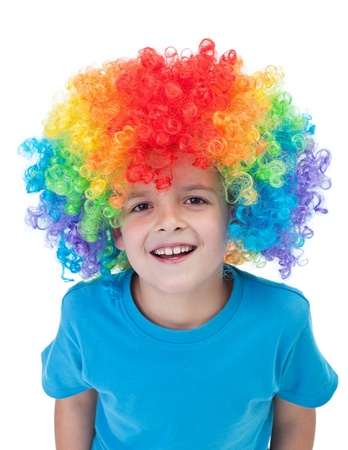 Happy clown boy with large colorful wig - isolated photo