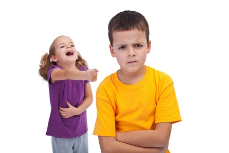 malice: School bully and mockery concept with laughing girl and upset boy Stock Photo