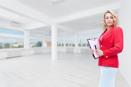 Real estate agent in large office space to let photo