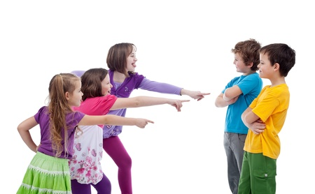 mocking: Girls mocking and making fun of boys - school bullying concept, isolated Stock Photo