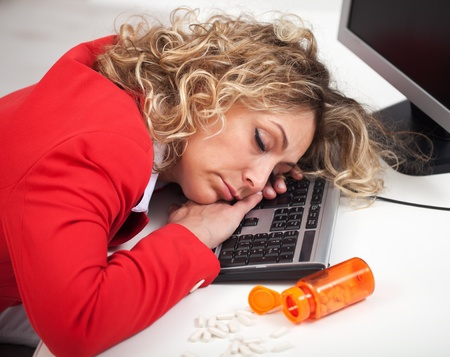 despite: Asleep at the office - woman sleeping despite energy pills