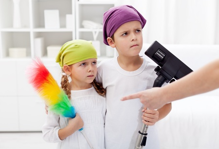 Kids forced to clean their room, parent hand pointing photo