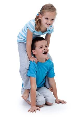 Happy kids playing and wrestling together - isolated photo
