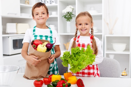 Healthy eating education - kids with vegetables in grocery bag photo