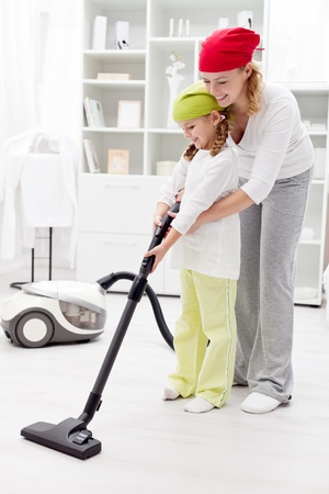 vacuum: Cleaning day in the family - using a vacuum cleaner