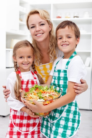 Healthy eating education concept - preparing a fresh salad with the kids Stock Photo - 12825324