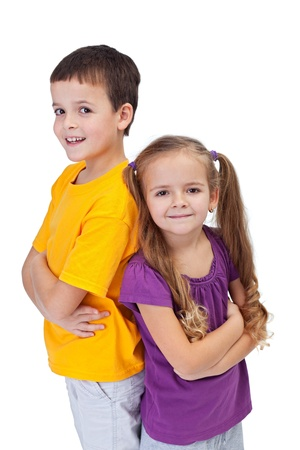 brothers and sisters: Two determined and confident kids standing next to each other