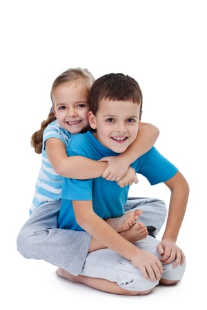 Happy wrestling kids playing together - isolated photo
