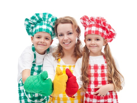 Colorful happy chefs with hats and aprons giving thumbs up sign - isolated photo